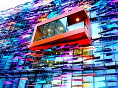 """The Richard Desmond Children's Eye Centre – London, UK. This occupies a state-of-the-art building with an animated facade that is a true visual delight. There are also folded aluminum louvers (""""seagulls"""") on the building's outer glass curtain wall."""