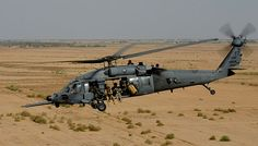A U.S. Air Force HH-60G Pave Hawk helicopter flies over the Iraqi desert, April 2009.