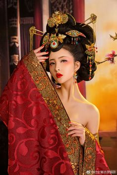 red model ~ similar positioning ~ ne pretty ~ modeling the hairstyle and the gold and red accessories including the earrings ~ very classic ~ very flattering ~ this makeup ~ highly artistic