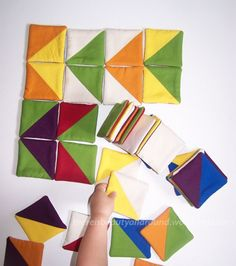 Fabric Tangram Puzzle - another amazing handmade toy. I make coasters using the same sewing method too!