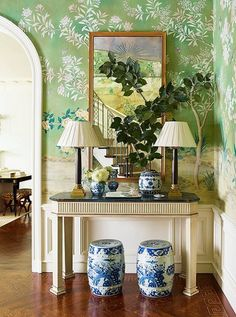Ashley Whittaker entry design // green floral wallpaper, blue and white ginger jar garden stools, and stylized console table Attic Renovation, Attic Remodel, Chinoiserie Wallpaper, Of Wallpaper, Amazing Wallpaper, Gracie Wallpaper, Wallpaper Panels, Chinoiserie Elegante, Entrance Foyer