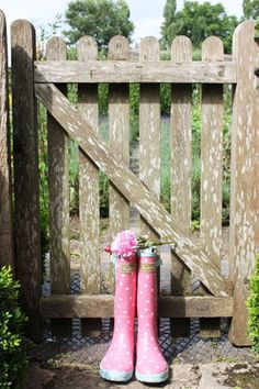 Garden gate, pink Wellington boots