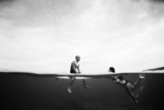 Underwater Wednesday : Oahu, Hawaii Underwater Photographer featuring a newly engaged couple in the ocean on the North Shore of Oahu