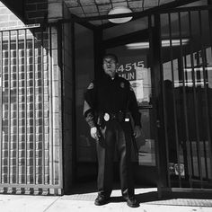 In Van Nuys in the San Fernando Valley (Northern LA), a security guard stands on duty outside of a U.S. Citizenship and Immigration Services (USCIS) Application Support Center. About 40% of the population in Los Angeles is foreign-born. @americanobscura for @streetvogs