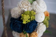ecoflower.com for bouquets made from recycled paper & wood and last forever!