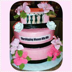 Three tier pink black and white cake