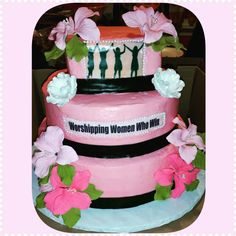 Three tier pink black and white cake