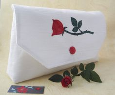 This unique envelope-style clutch bag is made from creamy white upcycled fabric that has a distinctive texture to it.  There is a single red rose appliqued onto the flap of the bag. Bridal Clutch Bag, Single Red Rose, Rose Applique, Wedding Purse, Applique Designs, Red Roses, Special Occasion, Occasion Bags, Floral Design