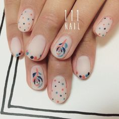ミナペルホネンのテキスタイルより 散りばめられたドットと刺繍風のお花が可愛いです▫️ #Nail#art #nailart…