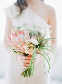 tropical bouquet, photo by Blush Wedding Photography http://ruffledblog.com/modern-tropical-wedding-inspiration #weddingbouquet #flowers