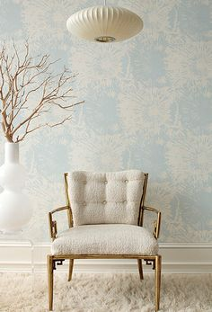 I'm sure this is supposed to be showcasing the chair...but I love this wallpaper