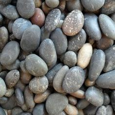 0.50 cu. ft. 5/8 in. to 7/8 in. 40 lb. Mixed Mexican Beach Pebbles (20-Bag Pallet) come from the beaches of Baja, Mexico and have been naturally smoothed and tumbled by ocean waves for hundreds of years. These beautiful stones are the perfect material to be used for drought tolerant, water wise dry-scape landscaping and gardening. The color hues of grey, brown, rust, ivory to charcoal will create a dramatic, natural affect when used in gardens, ponds and s