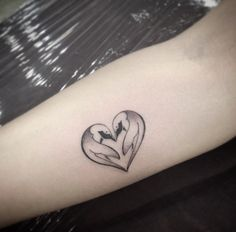 Heart-shaped penguin tattoo by Ivy Saruzi