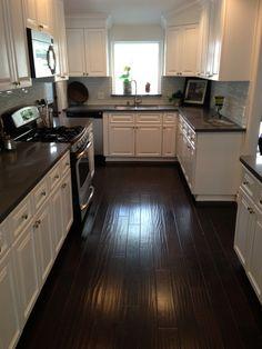 Image result for kitchen flooring white cabinets dark countertops