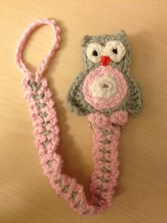Crochet pacifier clip  Here is where you can buy the pattern.   https://www.etsy.com/listing/153495250/sweet-baby-soother-clip-patterns?ref=cat_gallery_12  They are so much fun to make