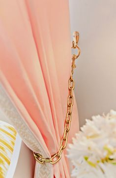 a teen bedroom in peach + mustard design dump: ORC finale: using chain + hardware store brass hook + clasp to create tiebacks