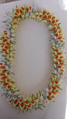The lei is approximately 36 inches long material/satin ribbon/silk flower