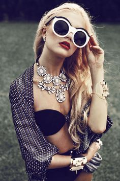 Big sunnies plus standout necklace and wristwear is simply glam !