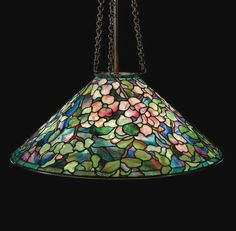 """TIFFANY STUDIOS  A FINE """"DOGWOOD"""" CHANDELIER    shade impressed TIFFANY STUDIOS NEW YORK  leaded glass and patinated bronze  53 1/2 in. (135.9 cm) maximum drop  28 3/8 in. (72.1 cm) diameter of shade  circa 1910"""