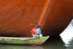 Indonesia. Jakarta. Port of Batavia. Boatsman in front of wooden schooner