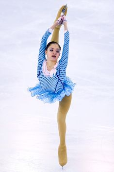 Evgenia Medvedeva of Russia performs during the Junior Ladies Short Program Final during day one of the ISU Grand Prix of Figure Skating Final 2014/2015 at Barcelona International Convention Centre on December 11, 2014 in Barcelona, Spain.