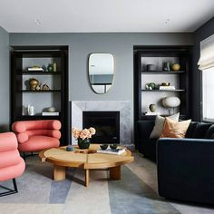 marble surround fireplace in blue-gray living room with curved furniture Living Room With Fireplace, Living Room Grey, Living Room Modern, Home Living Room, Living Room Designs, Living Spaces, Cozy Living, Eileen Gray, E Design