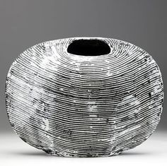 These elegant black and white slab-built vessels are by British artist James Tower (1919 - 1988).