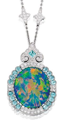 PLATINUM, BLACK OPAL, DIAMOND AND TOURMALINE NECKLACE Suspending a pendant centering an oval-shaped black opal weighing 12.34 carats, framed by 13 tourmalines weighing approximately 1.50 carats, the pendant and chain further set with round diamonds weighing approximately 1.25 carats, length 17¾ inches.