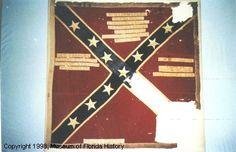 "Battle Flag of the 2ND REGIMENT Florida Volunteer Infantry. St. Andrew's cross design; square format. Size: 48"" x 49"". Bears unit designation: 2nd FLORIDA"