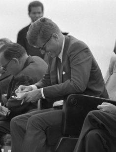 "jfk-and-jackie: """"Gov. Edmund G. Brown let out a howl, to the amusement of President John F. Kennedy after spilling a cup of coffee while watching special Navy maneuvers from the deck of the carrier."