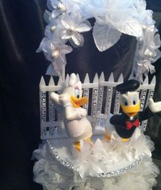 click here for your unique wedding cake topper http://uniqueweddingcreations.ca/product/donald-and-daisy-duck-wedding-cake-topper/ $95.00