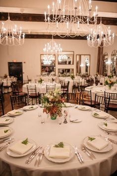 Idea: ferns tucked into the napkins of the simple place settings | Hip Autumn Wedding at Alden Castle in Brookline, MA | Photographer: Love and Perry