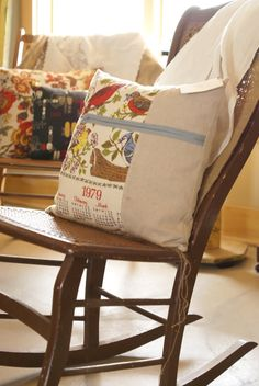 I love this pillow - I have a few I want to redo in this house, and I could dig this look
