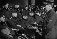 Heldengedenktag (Day of Commemoration of Heroes): Adolf Hitler talking to wounded soldiers in front of the Neue Wache Unter den Linden in Berlin March 10, 1940 (via juliamuller1889)