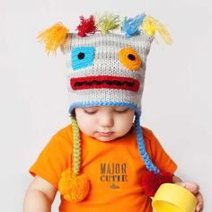 Just the cutest kids hat ever! This fun robot is made in softly striped grey yarn and accented with colorful tassel 'hair' and applicated eyes and mouth. Earflap style for extra warmth. Add our matching robot legwarmers to complete the look you see here.