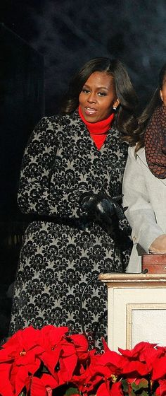 We love Michelle Obama's cozy printed coat and red turtleneck combination.