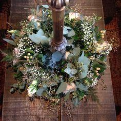Ring arrangement around a candelabra for a winter wedding