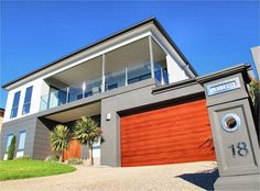 Large remote double garage. And exposed aggregate concrete driveway