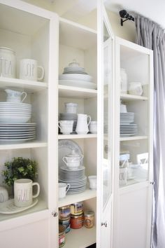 With curtains flanking these Billy Bookcases, this is exactly the way I want the dining room wall to look!
