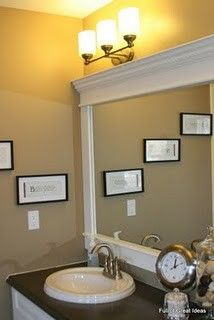 $30 to frame the mirror. This site has lots of ideas on changing up your home for pennies on the dollar.....no weird angle cuts!