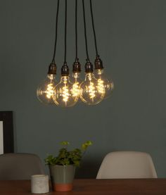 Our globe spiral filament warm glow LED filament bulb is a gorgeous, large spherical light bulb that will rival any vintage incandescent. Industrial Style Lighting, Vintage Lighting, Shop Lighting, Lighting Ideas, Vintage Light Bulbs, Contemporary Chandelier, Light Fittings, Spiral, Ceiling Lights
