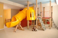 Indoor (basement) Playground. This would be great in the winter time! I want this in my next house.