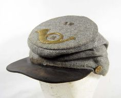Confederate Enlisted Kepi of Jean Wool. Bugle device indicates Infantry branch. 49th infantry Regiment, state unknown. CSA buttons