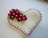 white felt heart with red flowers