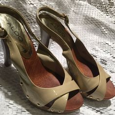 Aldo sandals Nude Aldo sandals/ upper leather/wood sole/size7/ 5'heels/ have scuffs on the right heel as shown in the last pic. ALDO Shoes Heels