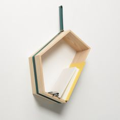 SLING , wall shelf design: Weena LEE