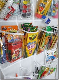 Use an over-the-door shoe bag to organize and store art supplies or manipulatives. Great for A but where to hang it?  On the left side of her newly painted white table?