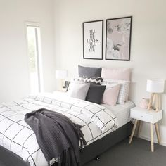 bedroom decor// grid comforter// large frames// wood and white bedside table// wood and white lamp// throw pillow colors