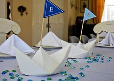 Nautical themed baby boy shower by @ThePomegranateBasket. I am obsessed with these little boats!
