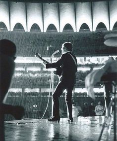 The Beatles in the rain. 8/21/66, St. Louis
